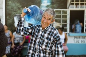 simple act of kindness ; man carrying water