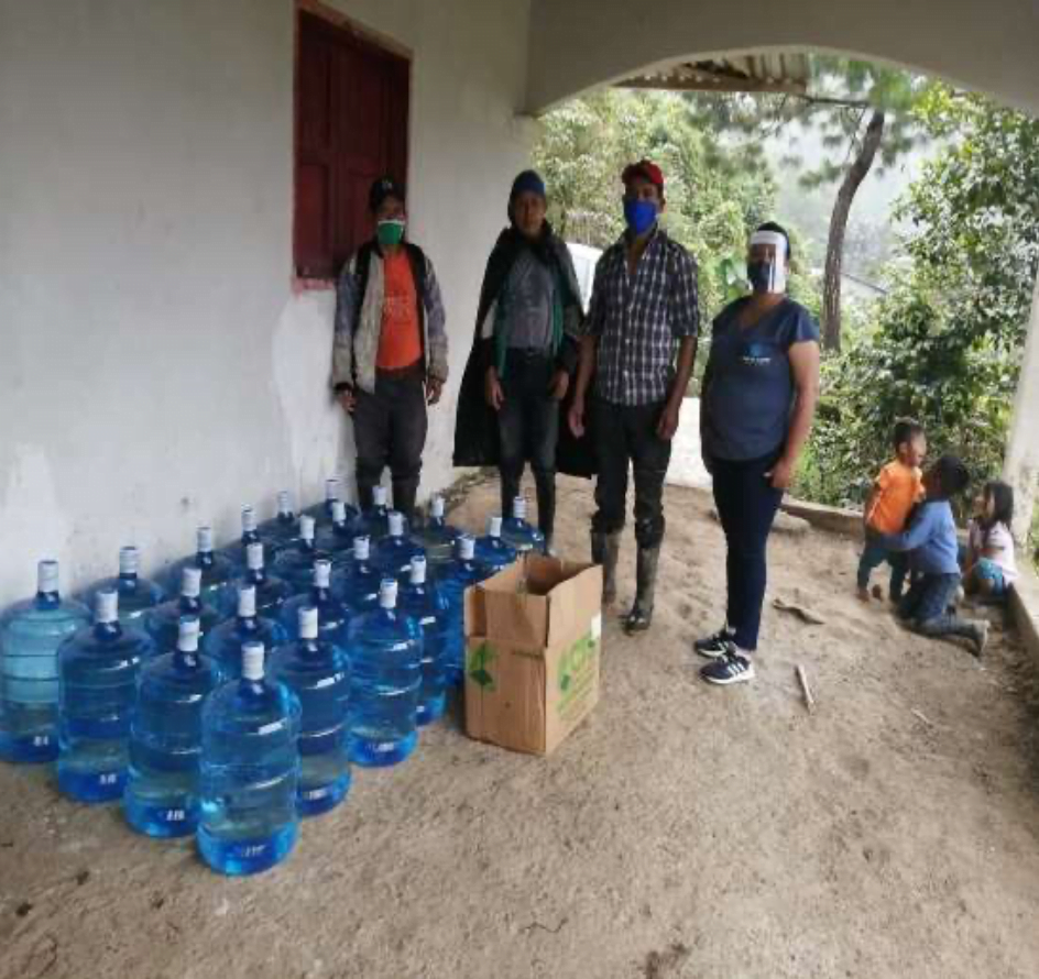 Grateful community members with emergency relief from Healing Waters